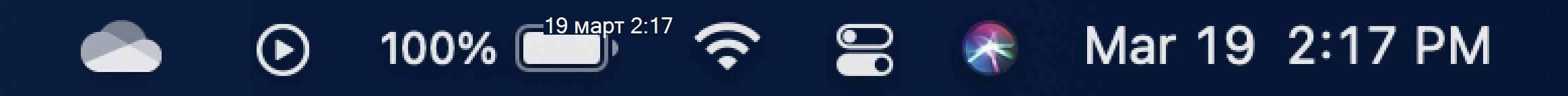 Показва лентата на задачите на Mac с иконата на облака на OneDrive.
