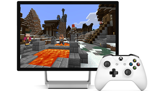 A surface Studio display is pictured, with Minecraft on the screen, along with an Xbox controller.