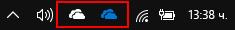 Лентата на задачите, показваща иконите на OneDrive