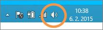Fokus na ikonu reproduktorů Windows zobrazenou na hlavním panelu