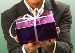 Man offering a present: (c) Royalty-Free/Corbis