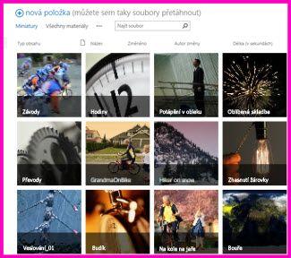 Snímek obrazovky s knihovnou materiálů v SharePointu. Znázorňuje miniatury několika videí a obrázků, které tato knihovna obsahuje. Zároveň zobrazuje standardní sloupce metadat pro multimediální materiály.