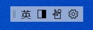 Uživatelské rozhraní panelu nástrojů editoru IME se zobrazeným tlačítkem režimu editoru IME, tlačítkem pro šířku znaků, položkou panelu editoru IME a tlačítkem Nastavení.