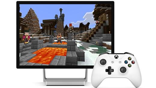 En Surface Studio-skærm vises, med Minecraft på skærmen, sammen med en Xbox-controller.