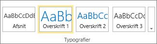 Skærmbilledet viser gruppen Typografier på båndet i SharePoint Online med typografien Overskrift 1 markeret.
