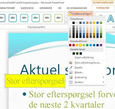 Oprette et tekstfelt med den tekst, der skal fremhæves, og bruge Fyldfarve til figur for farven