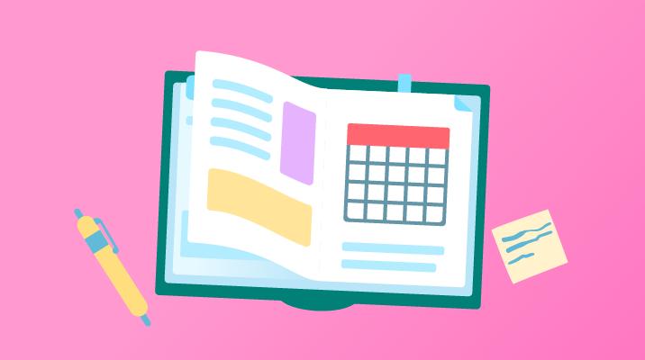 Ein geöffnetes Buch mit einem Kalender