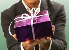 Man offering a present: (c) Royalty-Free/Corbis