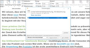 """Word-Dokument mit Dialogfeld """"Erinnerung"""" darüber"""