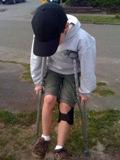 ten-year-old boy on crutches