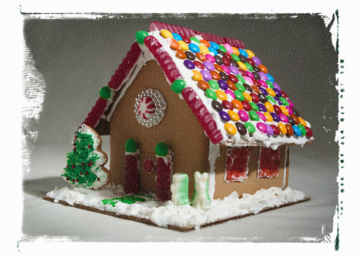 Partial view of a gingerbread house decorated with candy