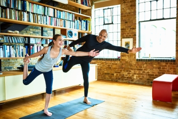 A father and daughter doing yoga