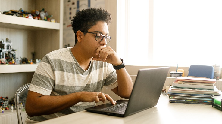 photo of a student working on a laptop