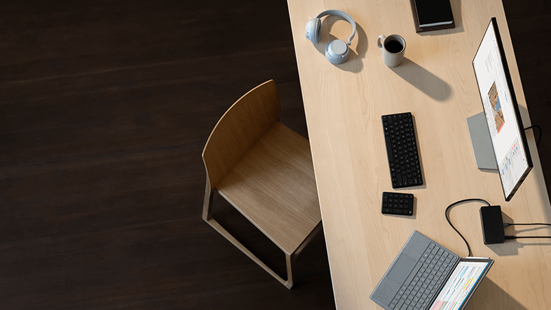 Surface Pro, Surface Headphones, mouse and keyboard on a desk