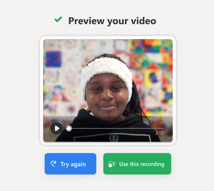 """the screen reads """"Preview your video"""" a Black student in a fuzzy white headband smiles in the video still. Below her buttons read """"Try again"""" and """"Use this recording"""""""
