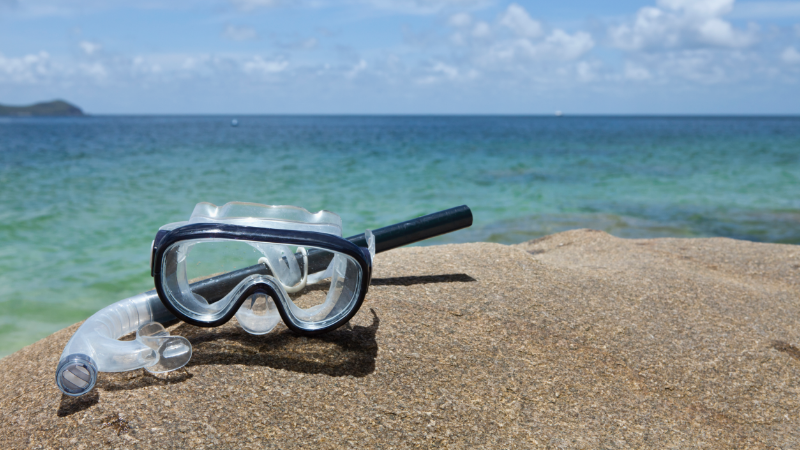 Snorkeling mask on a beach