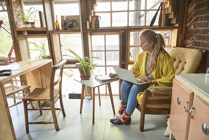 photo of a woman writing ideas on paper