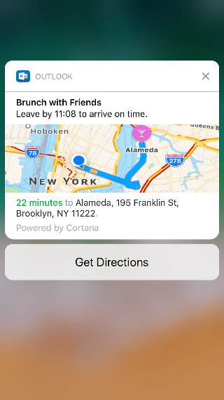 """Screen shows an Outlook notification that says """"Brunch with Friends. Leave by 11:08 to arrive on time"""" and includes a map, with the travel time estimate listed below it."""