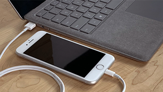 iPhone plugged into Surface