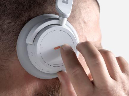 A man feeling the bump label on his headphones.