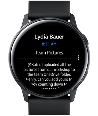 Shows a Samsung Galaxy watch with an email on the screen.