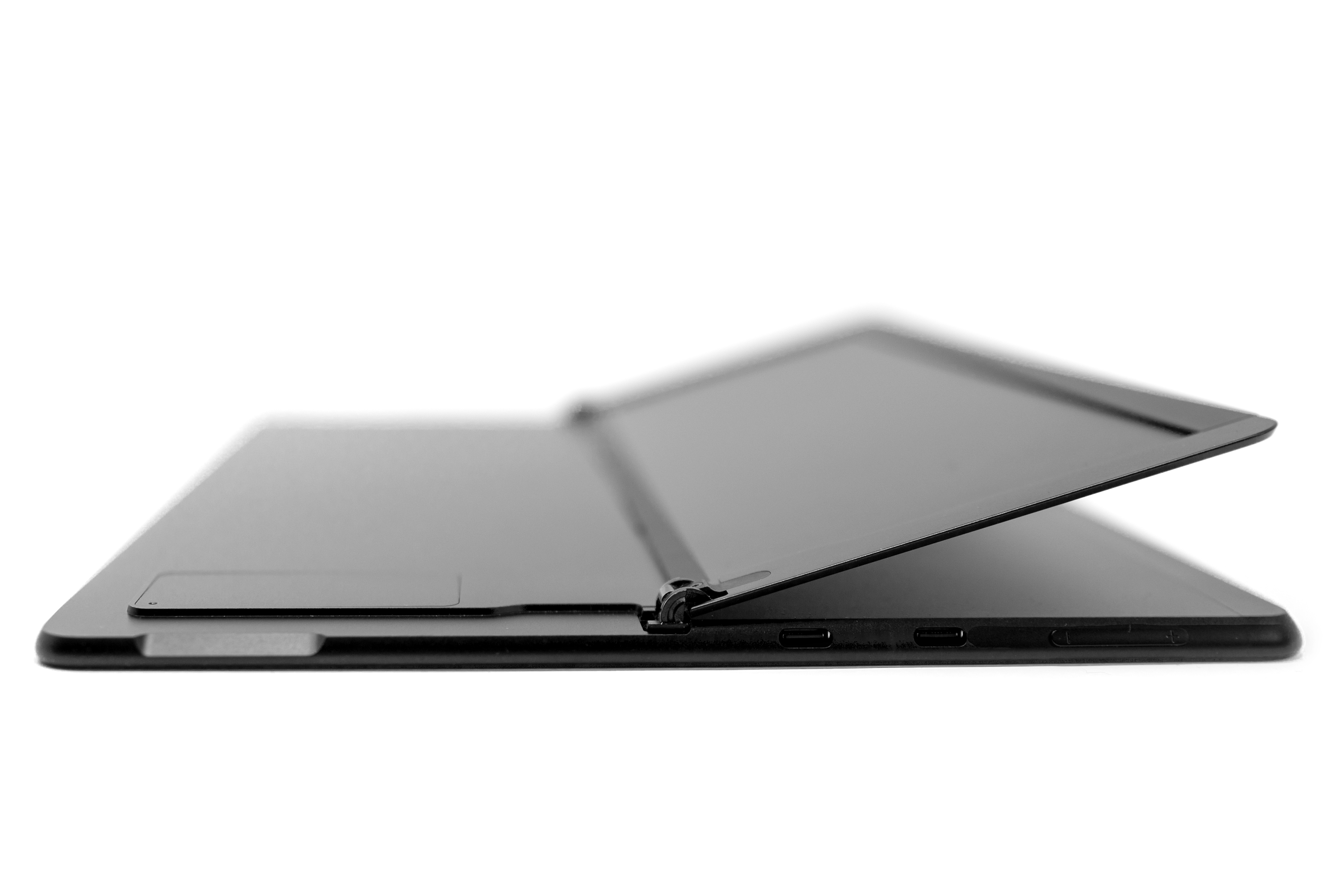 A Surface Pro X with the kickstand lifted to reveal a SIM door.