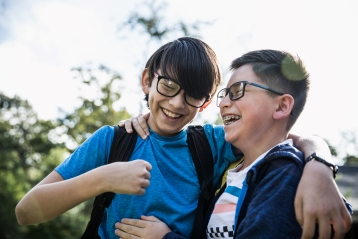 Two young boys laughing