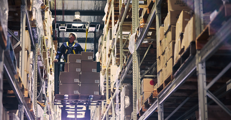 Picture of a man on a forklift in a warehouse