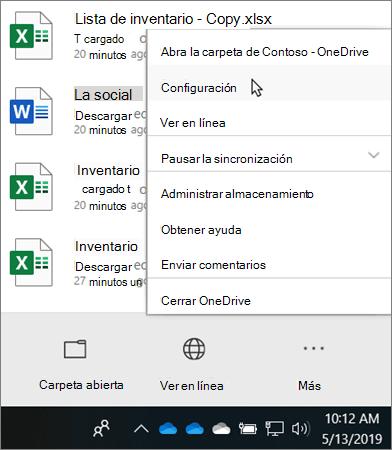 El menú del centro de actividades que aparece al hacer clic en el icono de Educación de OneDrive
