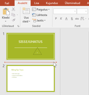 Punane horisontaaljoon näitab, kuhu uus slaid või uued slaidid lisatakse.