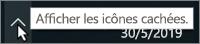 Barre d'état système Windows avec une flèche indiquant les icônes masquées