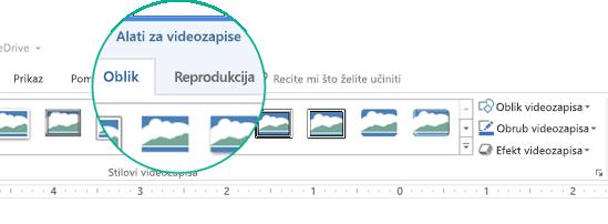 """Kada na slajdu odaberete videozapis, na vrpci alatne trake pojavit će se odjeljak """"Alati za videozapise"""" s dvije kartice: Oblikovanje i Reprodukcija."""
