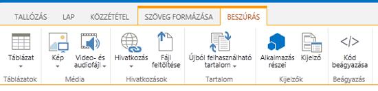 A Beszúrás lap képe gombokkal a táblázatok, videók, grafikus elemek és hivatkozások webhelyre való beszúrásához