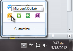 Notification area expanded to show the Outlook icon