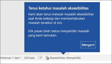 Bilah status memperlihatkan Pemeriksa Aksesibilitas sedang berjalan
