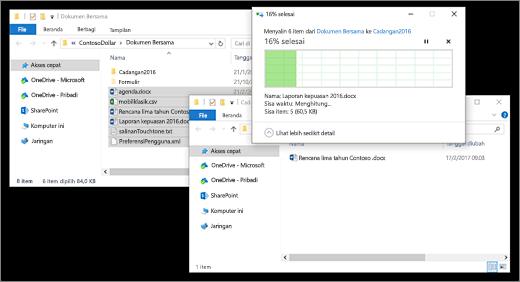 menyalin file antara dua jendela File Explorer