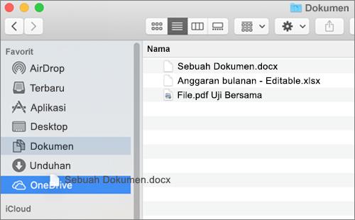 Jendela Finder Mac memperlihatkan drag-and-drop untuk memindahkan file