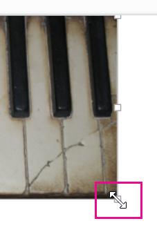 Seret gagang pengatur ukuran gambar untuk menutupi slide