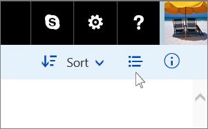 Kluster tombol pada sudut kanan atas yang berisi tombol dua arah gambar mini/rincian.