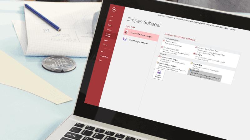 Laptop dengan layar memperlihatkan database Access yang sedang disimpan.