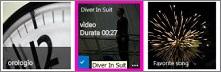 Schermata di una raccolta video. Due video della raccolta contengono immagini di anteprima del contenuto del video e in un'immagine è visualizzata solo una sequenza.