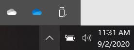 OneDrive の個人用および職場または学校の同期アイコン。