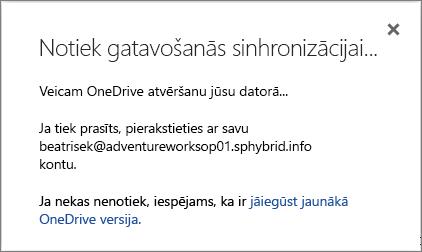 Ekrānuzņēmums ar sagatavošanās sinhronizēšanai dialoglodziņu, iestatot OneDrive darbam sinhronizēšanu