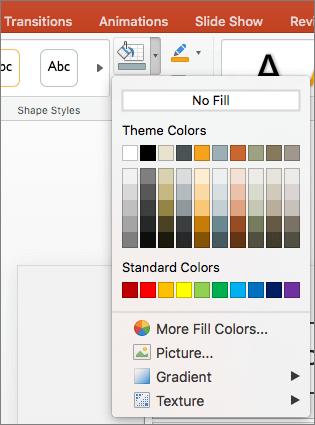 Ekrānuzņēmumā ir redzamas opcijas izvēlnē Formas aizpildījums, tostarp Bez aizpildījuma, Dizaina krāsas, Standarta krāsas, Vairāk aizpildījuma krāsu, Attēls, Gradients un Faktūra.