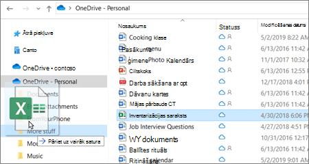 Attēls, kurā redzama faila pārvietošana uz citu mapi pakalpojumā OneDrive.