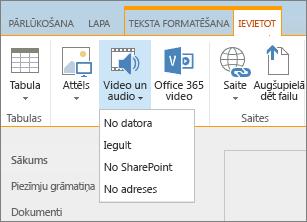 Ekrānuzņēmums ar SharePoint Online lenti. Atlasiet cilni Ievietošana un pēc tam atlasiet Video un Audio, lai norādītu, vai pievienot failu no datora, SharePoint atrašanās vietas vai tīmekļa adreses vai izmantot iegultu kodu.