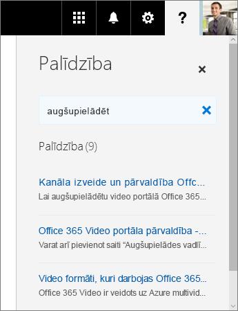 """Ekrānuzņēmums ar Office365 video palīdzības rūti, kurā redzami rezultāti meklēšanas vaicājumam """"augšupielādēt""""."""