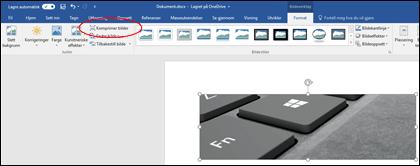 Komprimer bilde-knappen i Juster-gruppen på fanen Format under Bildeverktøy