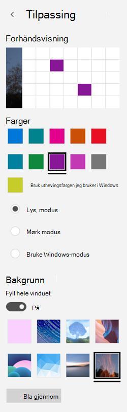 Velg et bakgrunnsbilde og egendefinerte farger for apper