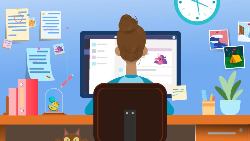 Lærer eller elev som ved et skrivebord som bruker en datamaskin